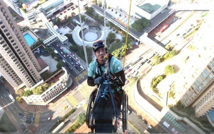 In Wheelchair, Man Climbs Up Skyscraper In Hong Kong