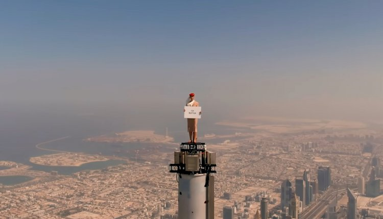 Emirates Fly Attendant Do A Crazy Stunt By Standing On The Top Of The Burj Khalifa.